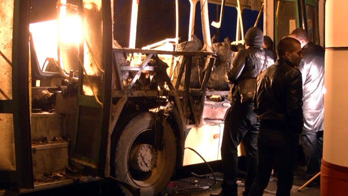Volgograd law enforcement agents work inside a passenger bus blown up Monday afternoon by a female suicide bomber in Krasnoarmeysky District, Volgograd (RIA Novosti/ Irina Il'icheva)