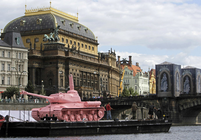 A Soviet WW II tank painted pink is located on a boat in front of the National Theatre in Prague June 20, 2011. (Reuters/David W Cerny)