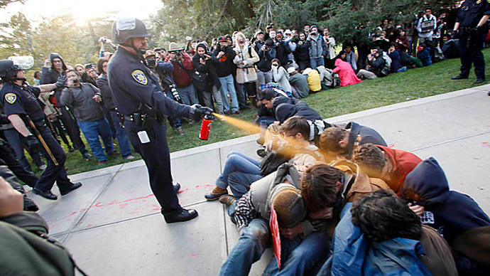 UC Davis Police Lieutenant John Pike uses pepper spray against peaceful Occupy UC Davis protesters (Photo by Wayne Tilcock)