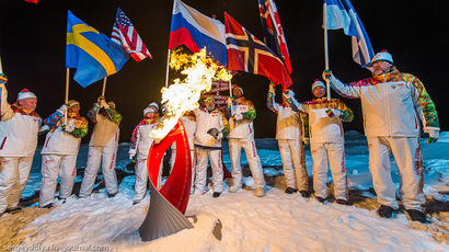 Sochi spacewalk: Olympic torch ventures out from ISS for first time