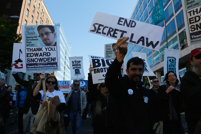 "Demonstarators carry signs at the ""Stop Watching Us: A Rally Against Mass Surveillance"" march near the U.S. Capitol in Washington, October 26, 2013. (Reuters / Jonathan Ernst)"
