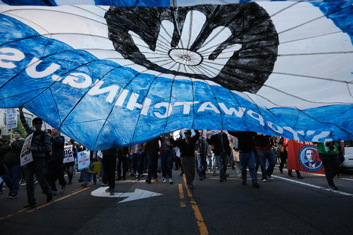 "Demonstarators carry a parachute during the ""Stop Watching Us: A Rally Against Mass Surveillance"" march near the U.S. Capitol in Washington, October 26, 2013. (Reuters / Jonathan Ernst)"