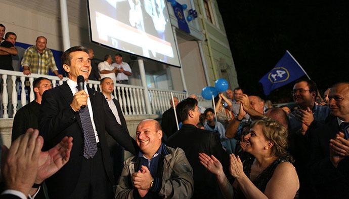 Bidzina Ivanishvili (L) addressing his supporters on October 1, 2012. (AFP Photo / Giorgy Kakulia)