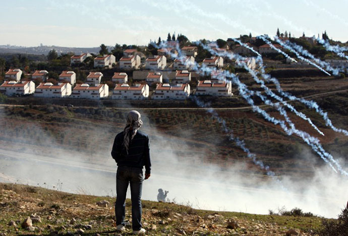 Israeli soldiers fire tear gas at Palestinian protesters during a weekly demonstration against the construction and expansion of settlements on village lands in the West Bank village of Nabi Saleh, near Ramallah (AFP Photo / Abbas Momani)