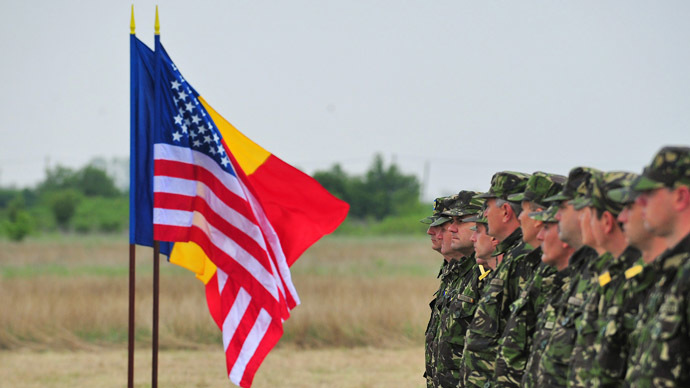 Romanian army personnel stand next to the US and Romanian flags during the inauguration ceremony of the location for installing US anti-missile shields at Deveselu air unit, some 240 km southwest of Bucharest on May 3, 2011. (AFP Photo)