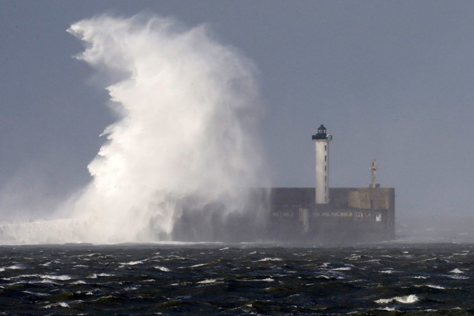 Waves crash against a lighthouse during a storm named Christian that battered France at Boulogne sur Mer northern France October 28, 2013. (Reuters/Pascal Rossignol)