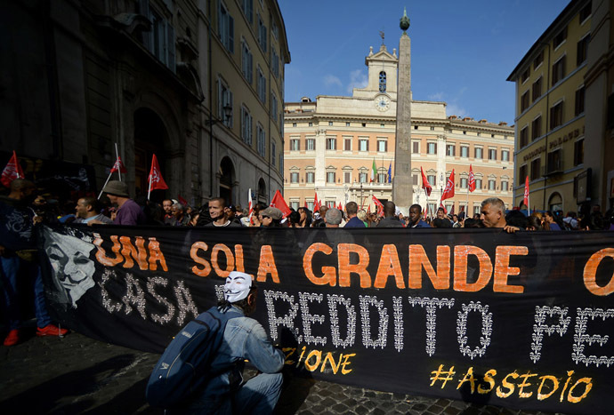 People take part in a demonstration to ask for affordable housings and against Government's austerity measures on October 31, 2013 in downtown Rome (AFP Photo/Filippo Monteforte)