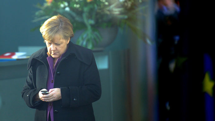 German Chancellor Angela Merkel using her mobile phone.(AFP Photo / Maurizio Gambarini)