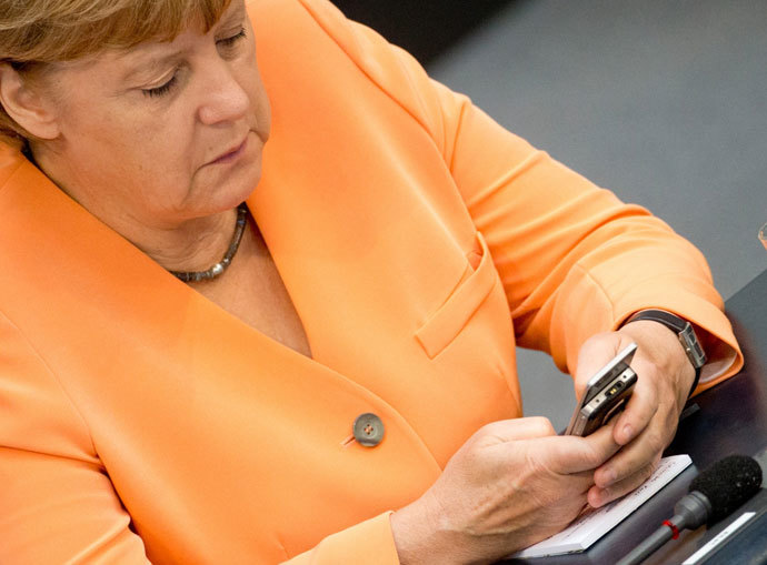German Chancellor Angela Merkel using her mobile phone.(AFP Photo / Kay Nietfeld)