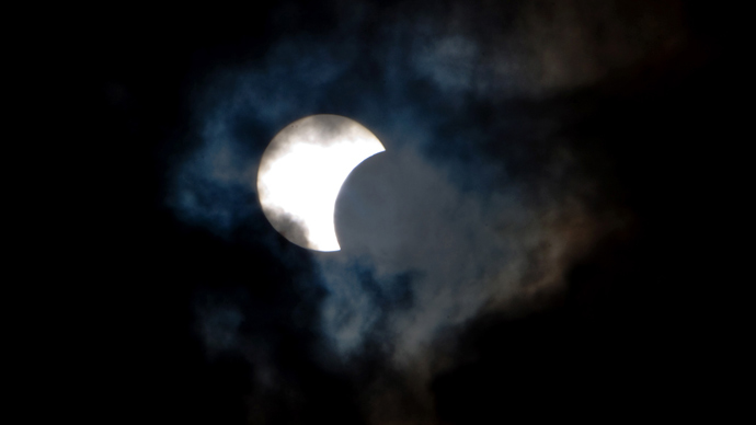 This picture taken on November 3, 2013 shows a rare hybrid solar eclipse through clouds from the Canary Island of Tenerife (AFP Photo / Desiree Martin)