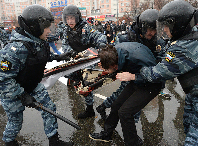 "Law enforcement officers detain a participant of the ""Russian March-2013"" in Moscow on November 4, 2013. (RIA Novosti / Iliya Pitalev)"