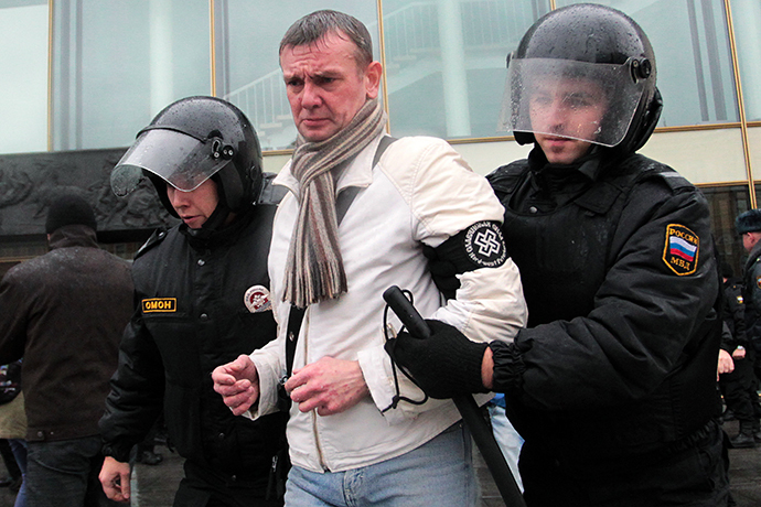 "Law enforcement officers detain a participant of the ""Russian March-2013"" in Saint Petersburg on November 4, 2013. (RIA Novosti / Anatoly Medved)"