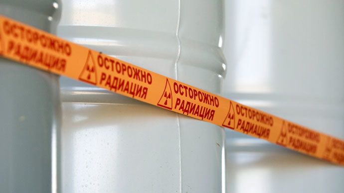 "Barrels filled with yellowcake,""Caution. Radiation"".(Reuters / Shamil Zhumatov)"