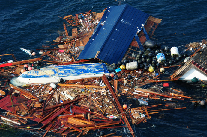 In this image released by the US Navy Visual News Service March 14, 2011 shows an aerial view of debris on March 13, 2011 from an 8.9 magnitude earthquake and subsequent tsunami that struck northern Japan. (AFP Photo/Navy Visual News Service/Mass Communication Specialist 3rd Class Alexander Tidd)