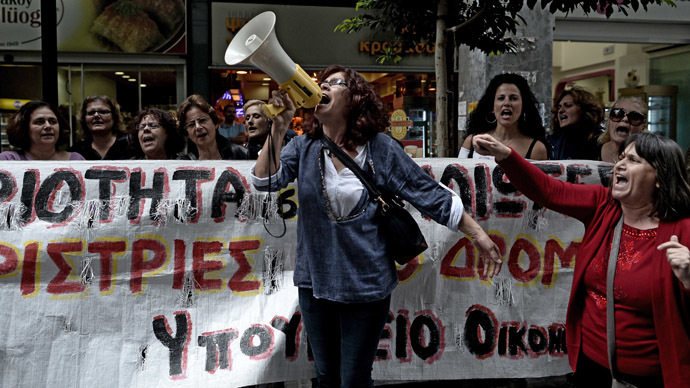 Greek riot police raid former state broadcaster's HQ, end journalists' sit-in
