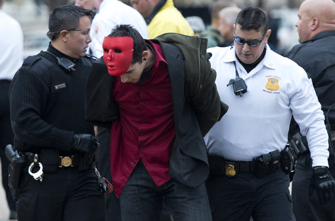 Police arrest a protestor during a march against corrupt governments and corporations organized by supporters of the group Anonymous, in front of the White House in Washington, DC, November 5, 2013, as part of a Million Mask March of similar rallies around the world on Guy Fawkes Day. (AFP Photo/Saul Loeb)
