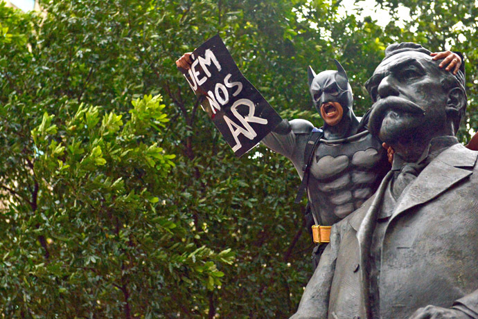 A man disguised as super hero Batman takes part in a demonstration for the Guy Fawkes World Day in Rio de Janeiro, Brazil on November 5, 2013. (AFP Photo/Christophe Simon)