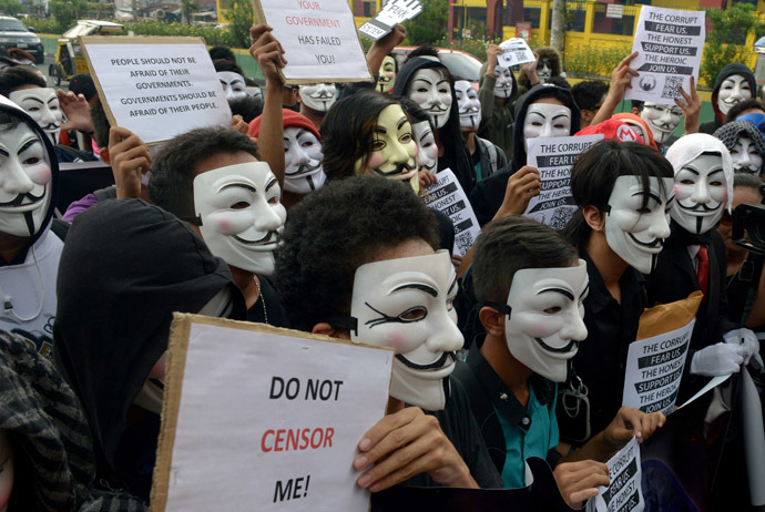 Protesters wearing Guy Fawkes masks display placards during a rally outside the House of Representatives in suburban Quezon city, north of Manila on November 5, 2013. (AFP Photo/Jay Directo)