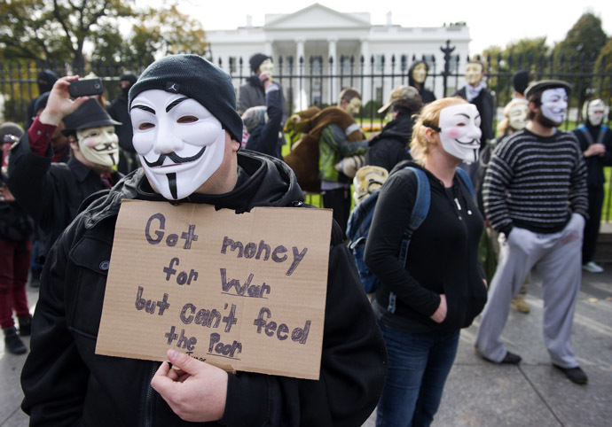 Demonstrators, including supporters of the group Anonymous, march in a protest against corrupt governments and corporations in front of the White House in Washington, DC, November 5, 2013, as part of a Million Mask March of similar rallies around the world on Guy Fawkes Day. (AFP Photo/Saul Loeb)