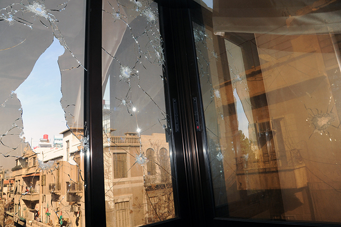 A handout picture released by the official Syrian Arab News Agency (SANA) shows damages windows in a building on Hijaz square, where eight were allegedly killed and another 50 wounded in a bomb blast on November 6, 2013 in Damascus, Syria. (AFP Photo)