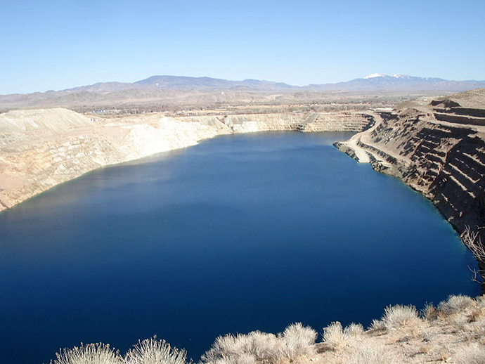 Anaconda Copper Mine. Inactive since 1978, the pit has flooded. (Photo by Kelapstick / wikipedia.org)