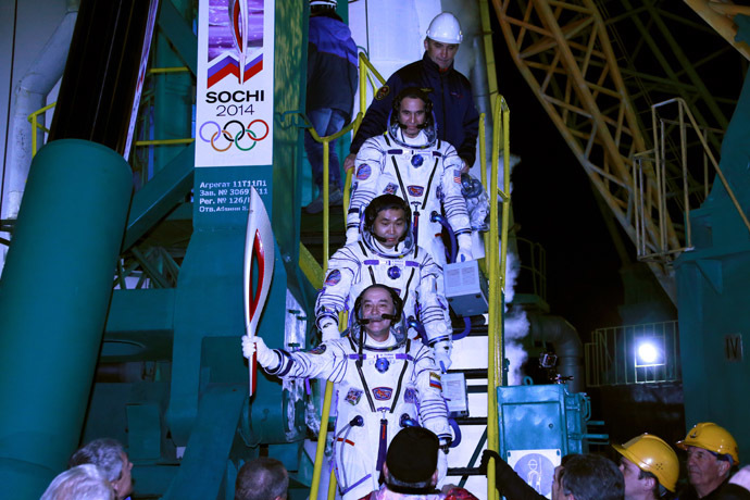 JAXA astronaut Koichi Wakata, RSA cosmonaut Mikhail Tyurin and NASA astronaut Richard Mastracchio (bottom to top) boarding the spacecraft. (RIA Novosti/Anton Denisov)