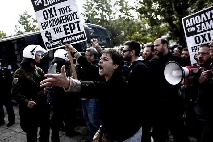 A demonstrator shouts at riot police on November 7, 2013 outside the headquarters of former public broadcaster ERT in Athens. (AFP Photo/Louisa Gouliamaki)