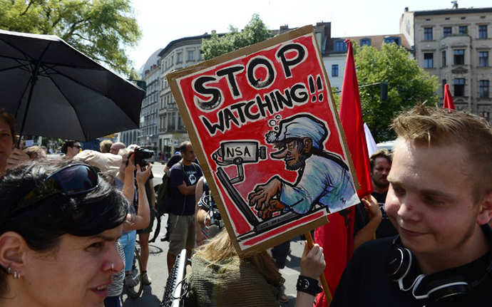 Demonstrators take part in a protest against the US National Security Agency (NSA) collecting German emails, online chats and phone calls and sharing some of it with the country's intelligence services in Berlin on July 27, 2013 (AFP Photo / John Macdougall)