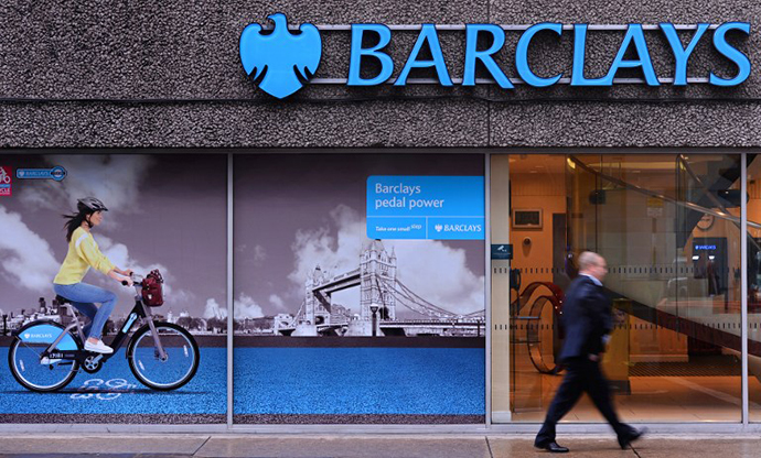 A man walks past a branch of Barclays bank in central London (AFP Photo / Carl Court)