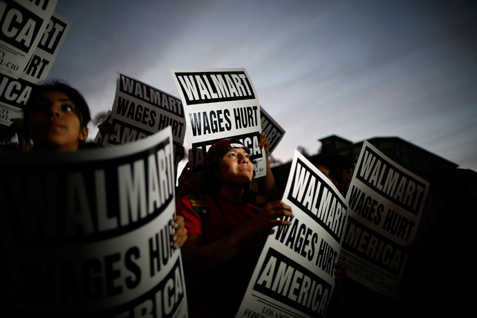Pedro Taverna, 18, takes part in a protest for better wages outside Wal-mart in Los Angeles November 7, 2013. (Reuters / Lucy Nicholson)