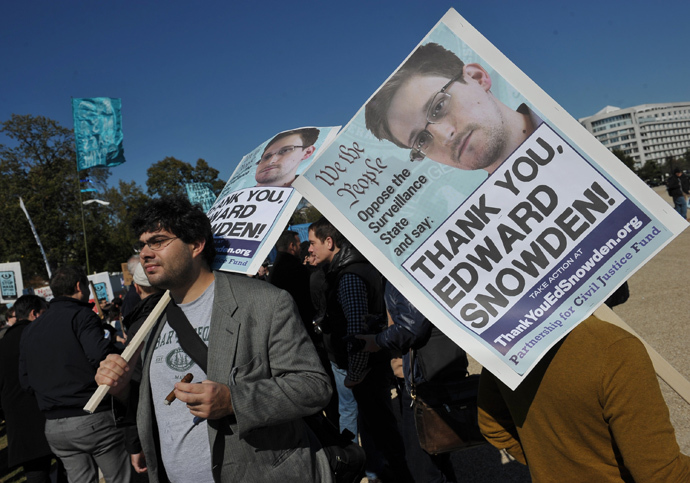 Demonstrators hold placards supporting former US intelligence analyst Edward Snowden during a protest against government surveillance in Washington, DC. (AFP Photo / Mandel Ngan)