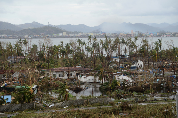 A general shot shows fallen trees and destroyed houses in the aftermath of Super Typhoon Haiyan in Tacloban, eastern island of Leyte on November 9, 2013. (AFP Photo / Noel Celis)