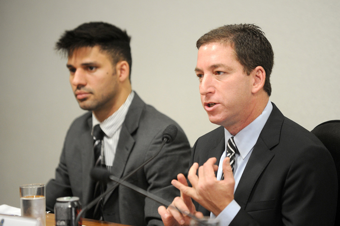 The Guardian's Brazil-based reporter Glenn Greenwald (R), who was among the first to reveal Washington's vast electronic surveillance program, accompanied by his partner David Miranda (AFP Photo)