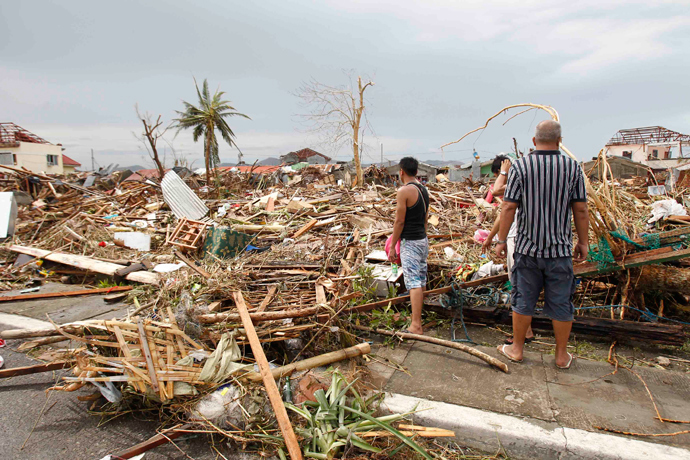 Survivors assess the damage after super Typhoon Haiyan battered Tacloban city, central Philippines November 9, 2013 (Reuters)