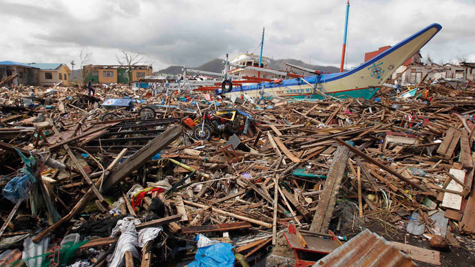 A fishing boat which slammed into damaged houses lie atop debris after super Typhoon Haiyan battered Tacloban city, central Philippines November 10, 2013. (Reuters / Romeo Ranoco)