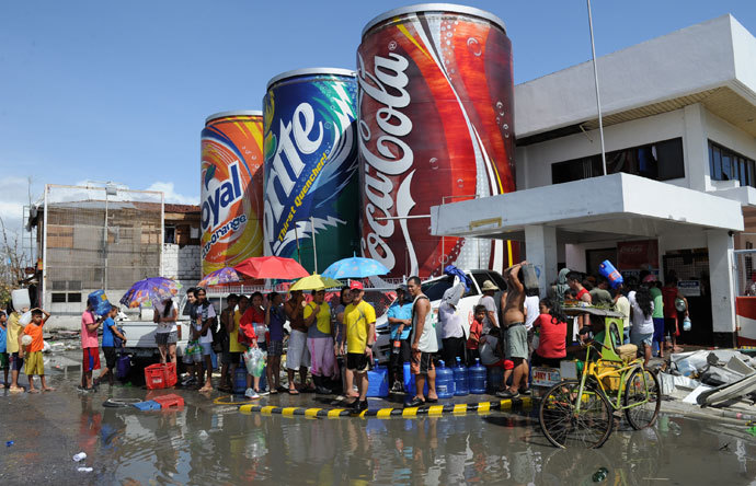 Residents fetch free water at a plant of a softdrink company in Tacloban City, Leyte province, central Philippines on November 10, 2013 after Super Typhoon Haiyan swept over the Philippines.(AFP Photo / Ted Aljibe)