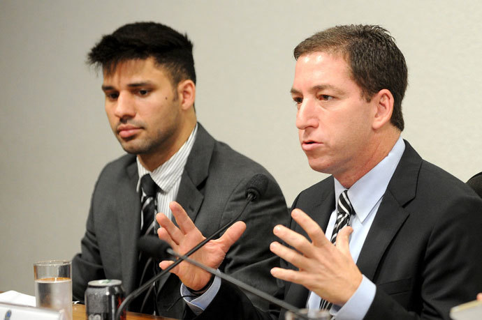 The Guardian's Brazil-based reporter Glenn Greenwald (R),and his partner David Miranda.(AFP Photo / Evaristo Sa )