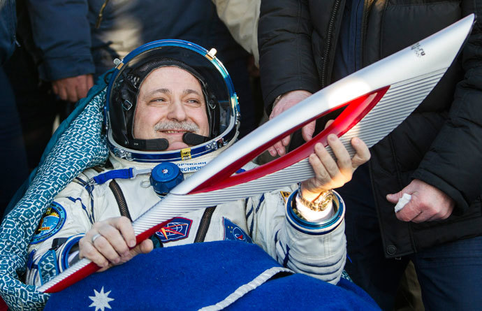International Space Station (ISS) crew member Russian cosmonaut Fyodor Yurchikhin holds the torch of the 2014 Sochi Winter Olympic Games after landing near the town of Zhezkazgan in central Kazakhstan November 11, 2013. (Reuters / Shamil Zhumatov)