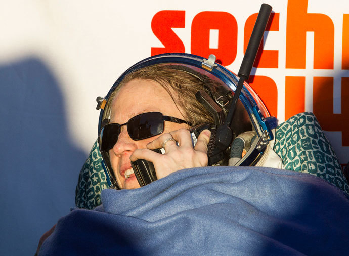 The International Space Station (ISS) crew member of U.S. astronaut Karen Nyberg speaks on a satellite phone after landing in a remote area near the town of Zhezkazgan in central Kazakhstan November 11, 2013.(Reuters / Shamil Zhumatov)