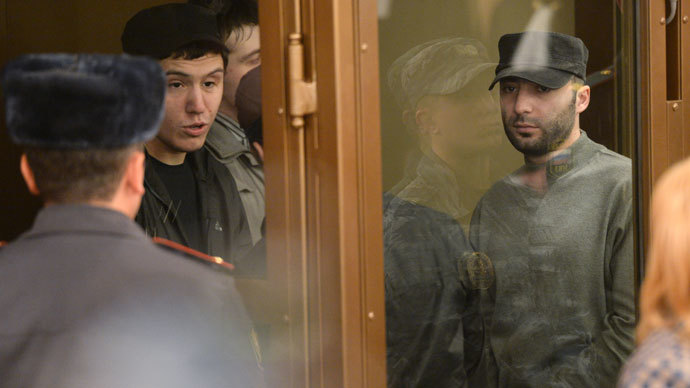 Bashir Khamkhoyev, left, and Islam Yandiyev, defendants in the Domodedovo airport terror attack case, during the announcement of the sentences at the Moscow Region Court.(RIA Novosti / Alexey Filippov)