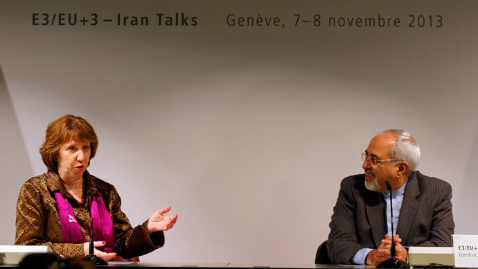Iranian Foreign Minister Mohammad Javad Zarif (R) listens to European Union foreign policy chief Catherine Ashton during a news conference after nuclear talks at the United Nations European headquarters in Geneva November 10, 2013.(Reuters / Denis Balibouse)