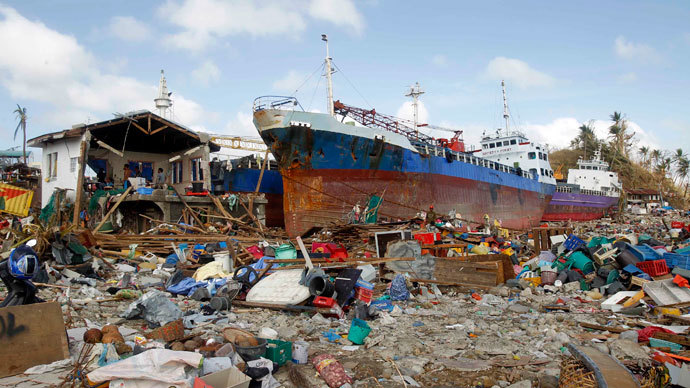 Cargo ships washed ashore are seen four days after super typhoon Haiyan hit Anibong town, Tacloban city, central Philippines November 11, 2013.(Reuters / Romeo Ranoco)