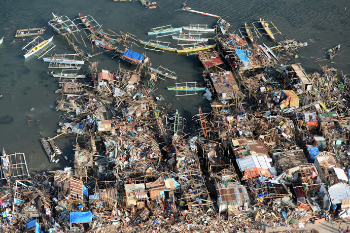 This aerial photo shows destroyed houses along the water in the town of Guiuan in Eastern Samar province in the central Philippines on November 11, 2013 only days after Super Typhoon Haiyan devastated the town on November 8. (AFP Photo/Ted Aljibe)