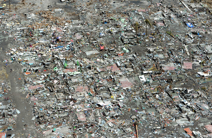 This aerial photo shows flattened houses in the city of Tacloban, Leyte province, in the central Philippines on November 11, 2013, only days after Super Typhoon Haiyan devastated the town on November 8. (AFP Photo/Ted Aljibe)