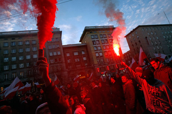 Far-right protesters light flares during their annual march, which coincides with Poland's national Independence Day in Warsaw November 11, 2013. (Reuters / Kacper Pempel)