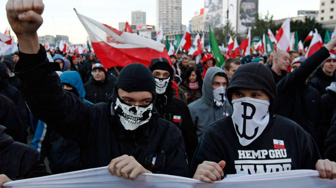 Far-right protesters with faces covered shout slogans during their annual march, which coincides with Poland's national Independence Day in Warsaw November 11, 2013.(Reuters / Kacper Pempel)