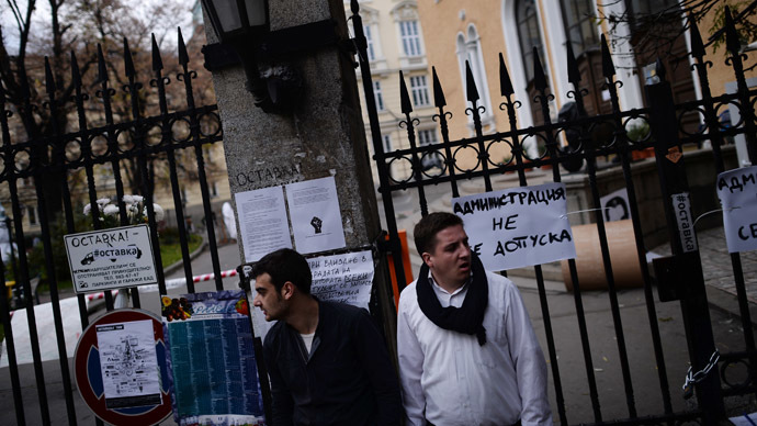 Students stand next a closed entrance of Sofia's university on November 11, 2013. (AFP Photo/Dmitar Dilkoff)