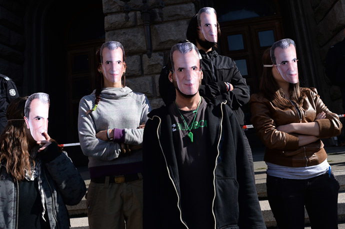 Students wear masks with a picture of Bulgarian Prime Minister Plamen Oresharski during an anti-government protest in Sofia on November 10, 2013. (AFP Photo/Dmitar Dilkoff)