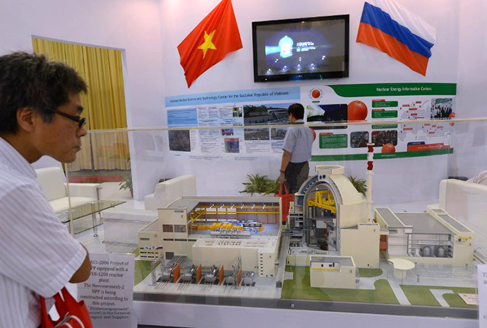 A visitor looks at a model of a Russian VVER-1200 nuclear reactor of which Vietnam's first nuclear power plant will be equipped of on diplay at an international nuclear power exhibition being held in Hanoi on October 26, 2012. (AFP Photo / Hoang Dinh Nam)