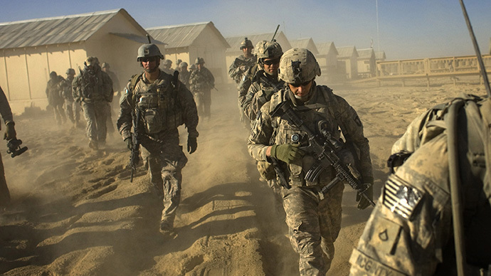 (FILES) US Army soliders set out on a patrol in Paktika province, situated along the Afghan-Pakistan border. (AFP Photo / David Furst)